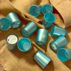 13 Tea-light candle holders.